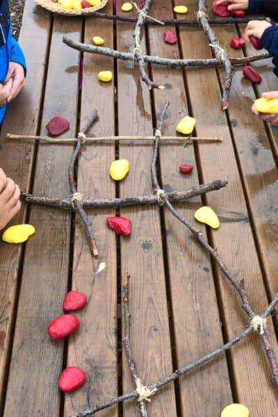 Rainy Day Play Ideas - Tic Tac Toe with rocks and sticks